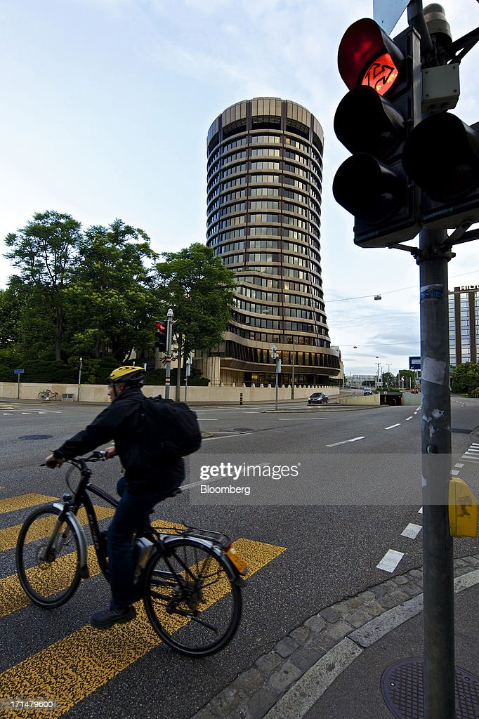 A cyclist rides a bicycle on a road near the headquarters of the Bank for International Settlements (BIS) in Basel, Switzerland, on Tuesday, June 25, 2013. Central banks can't expand loose monetary policy without exacerbating risks to world economies, the Bank for International Settlements said this week. Photographer: Gianluca Colla/Bloomberg via Getty Images
