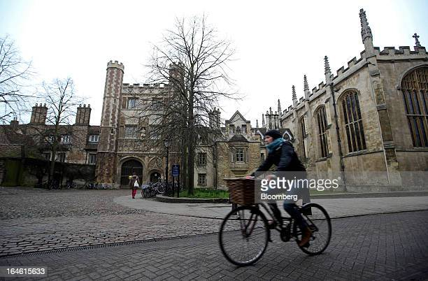 A cyclist rides a bicycle past Trinity College part of the University of Cambridge in Cambridge UK on Friday March 22 2013 In 2011 the UK's...