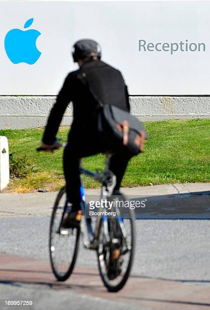 A cyclist rides a bike at Apple Inc's campus in Cork Ireland on Tuesday June 4 2013 Speaking to lawmakers in Dublin last month Irish Finance Minister...