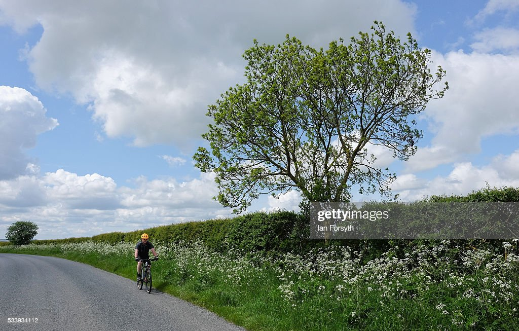 A cyclist rides along the road next to the KM8 drill site near the village of Kirby Misperton on May 24, 2016 in Malton, England. North Yorkshire Planning and Regulatory Committee voted seven to four in favour of a planning application submitted by Third Energy to conduct fracking at the KM8 drilling site near the village. Hydraulic Fracturing, or fracking, is a technique designed to recover gas and oil from shale rock.