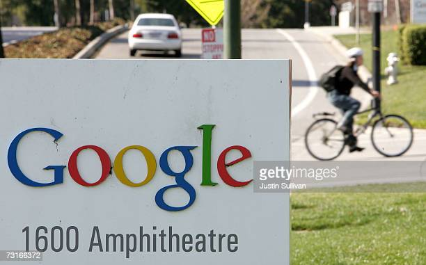 A cyclist rides behind the sign outside of Google headquarters January 31 2007 in Mountain View California Google Inc reported its fourth quarter...