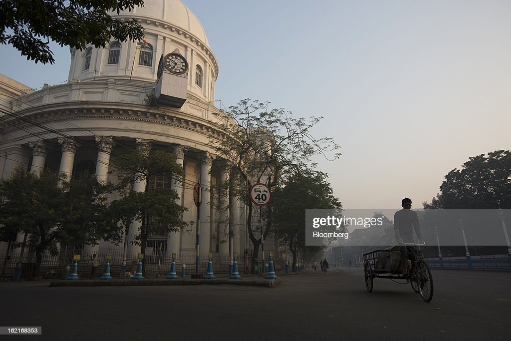 A cyclist rides down a street in the BBD Bagh area of Kolkata, India, on Tuesday, Feb. 19, 2013. India's slowest economic expansion in a decade is limiting profit growth at the biggest companies even as foreigners remain net buyers of the nation's stocks, according to Kotak Institutional Equities. Photographer: Brent Lewin/Bloomberg via Getty Images