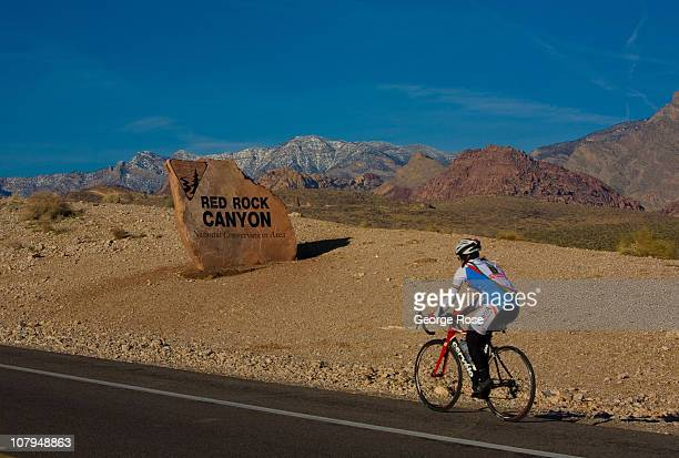 A cyclist rides her bike into the Red Rock Canyon National Conservation Area on December 26 2010 near Summerlin Nevada Red Rock Canyon located 15...