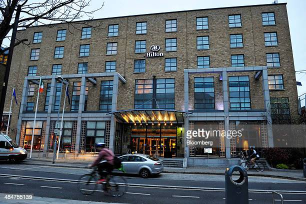 A cyclist rides his bicycle past the Hilton Dublin hotel operated by Lalco Hotel Group in Dublin Ireland on Tuesday April 8 2014 US Billionaire John...