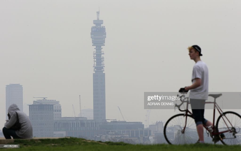 A cyclist rides his bike at the top of Primrose Hill in London on April 3 as the city below lies shrouded in pollution A combination of local...