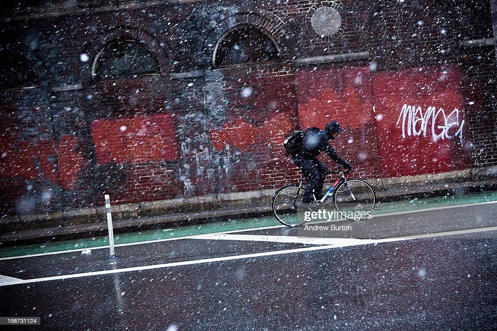 A cyclist rides his bike through a winter snowstorm on December 26, 2012 in New York City. Snow, mixed with and changing to rain, is expected to hit the New York City area this afternoon into the evening.