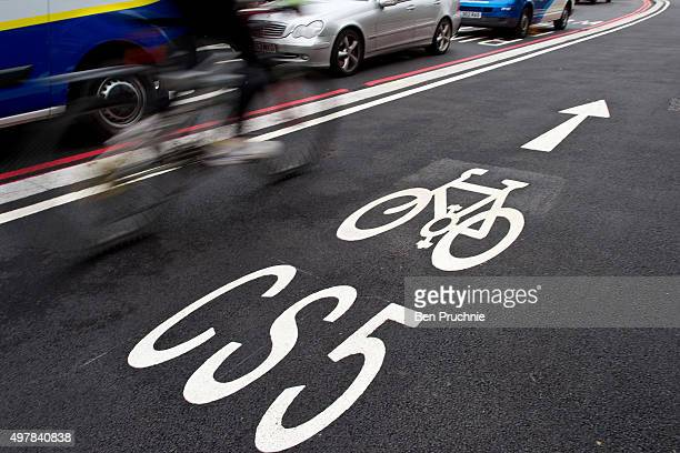 A cyclist rides over Vauxhall Bridge as Mayor of London Boris Johnson launches London's first cycle superhighway on November 19 2015 in London...