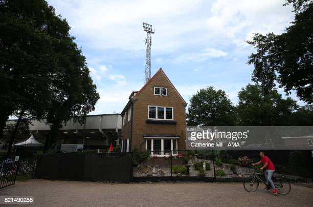 A cyclist rides past a residential house infront of the stadium before the UEFA Women's Euro 2017 match between Iceland and Switzerland at Stadion De...