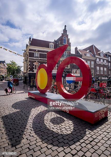 A cyclist rides past a Tour De France themed installation in Utrecht on June 24 2015 as preparations for the Grand Depart of the Tour De France get...