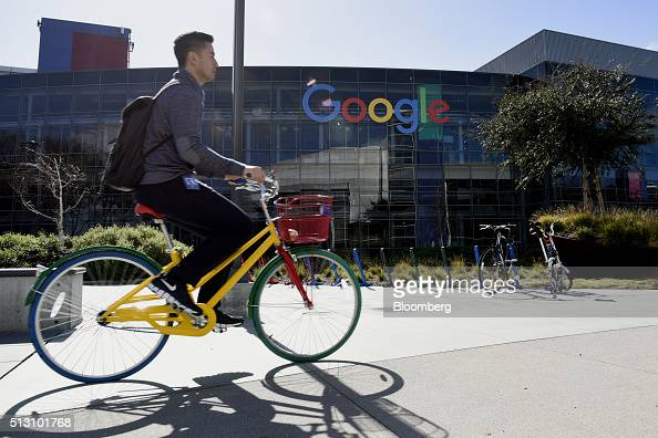 A cyclist rides past Google Inc offices inside the Googleplex headquarters in Mountain View California US on Thursday Feb 18 2016 Google part of...