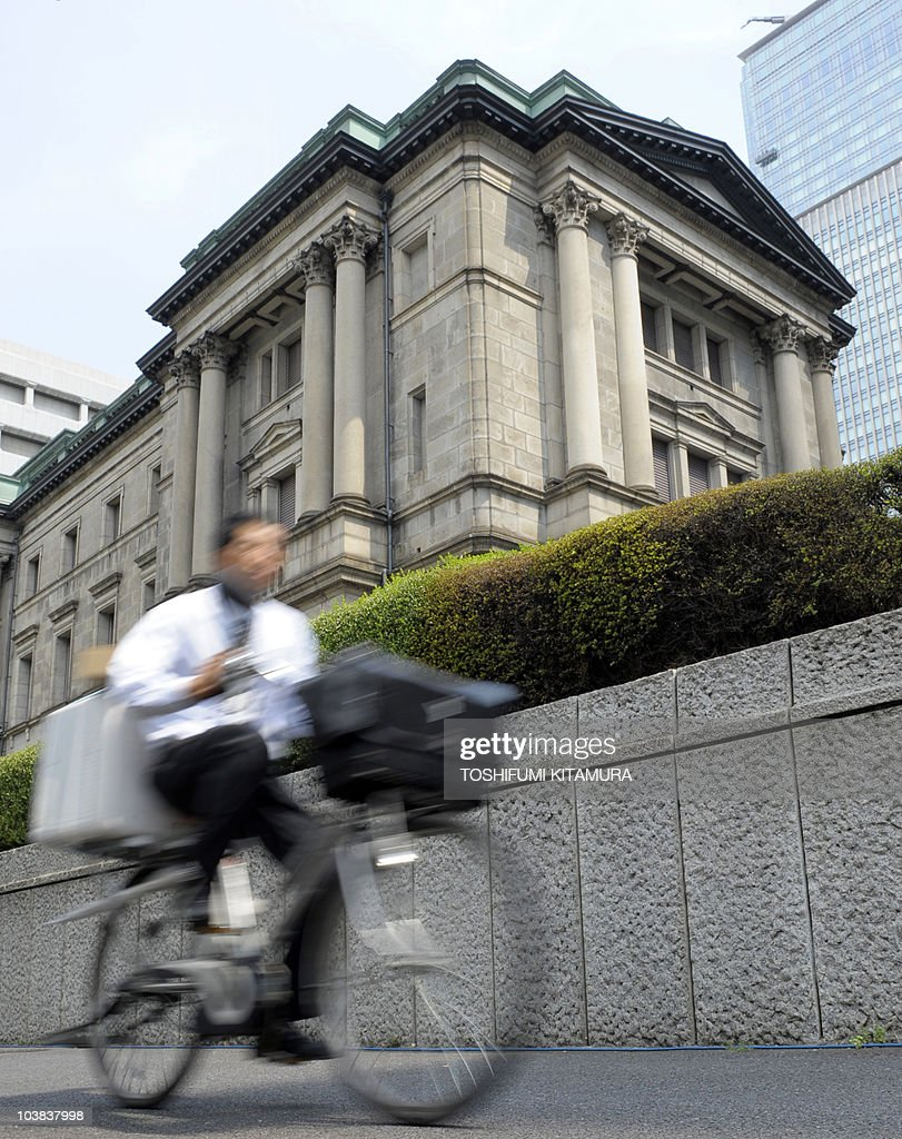 A cyclist rides past the Bank of Japan headquarters in Tokyo on August 30 2010 The US dollar rose against the yen in Asia on August 30 as the Bank of...