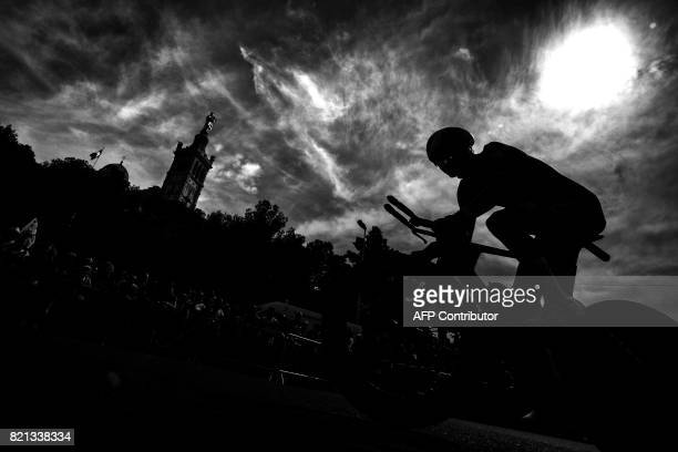 A cyclist rides past the NotreDame de la Garde basilica as he competes in a 225 km individual timetrial the twentieth stage of the 104th edition of...