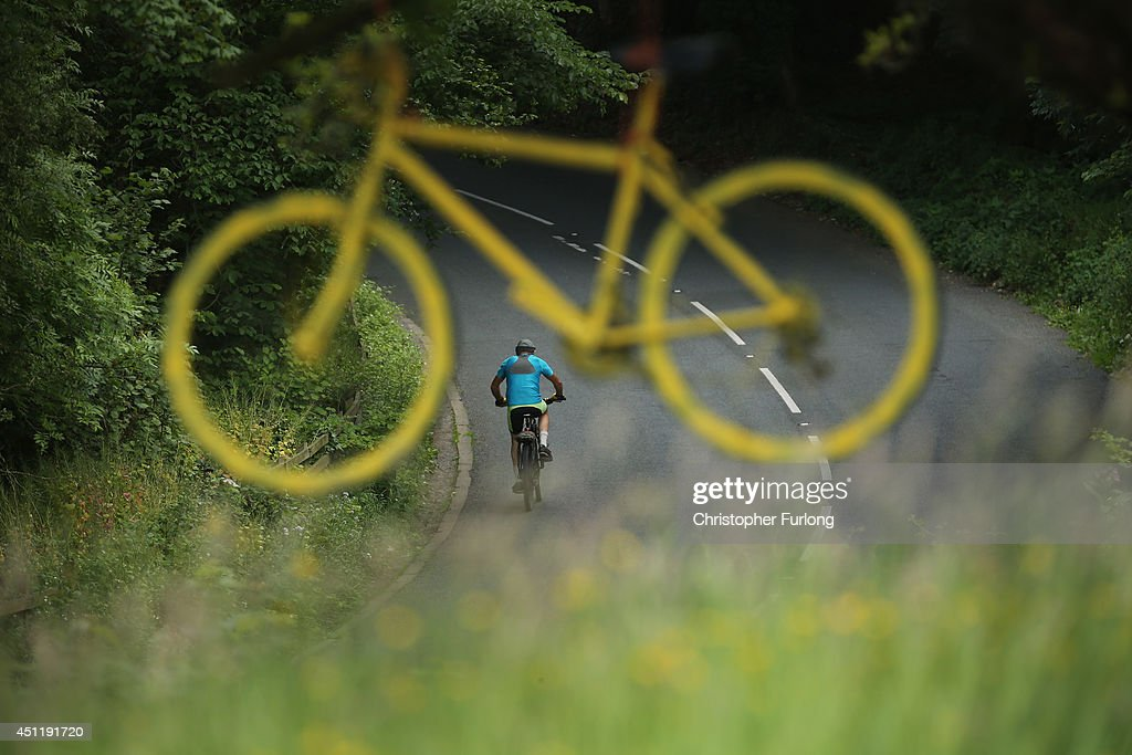 A cyclist rides the route of the Tour De France past a yellow bicycle hanging from a tree as Yorkshire prepares to host the Tour de France Grand Depart, on June 24, 2014 in Addingham, United Kingdom. The people of Yorkshire are preparing to give the riders of the 2014 Tour de France a grand welcome as the route of stages one and two are decorated with bunting, bikes and yellow jerseys The Grand Depart of the 2014 Tour De France is taking place in Leeds with the first two stages taking place across Yorkshire on 6th and 7th of July.