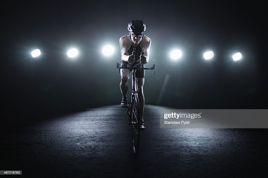 Cyclist riding at night in the city : Stock Photo