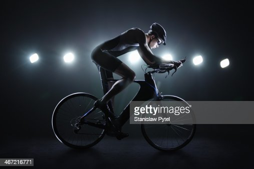 Cyclist riding at night in the city