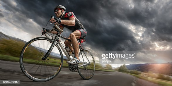 Cyclist Riding Hard To Outrun Storm