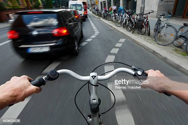 Cyclist riding on a marked cycle path in the city on August 05 in Berlin Germany Pedestrians and cyclists are particularly at risk in traffic