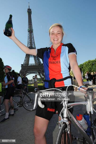 Cyclist Rona Askew from Settle Yorkshire completes the fundraising for Help for Heroes Band of Brothers bike ride at the Eiffel Tower Paris after the...