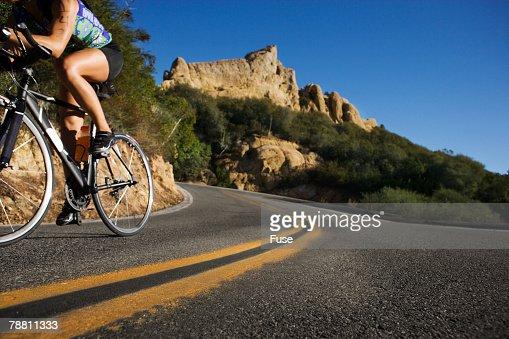 Cyclist Rounding a Curb During a Triathlon