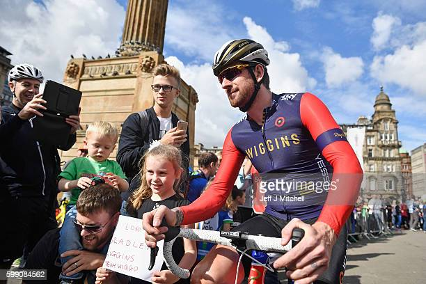 Cyclist Sir Bradley Wiggins makes his way through the crowd prior to the start of stage 1 of the Tour of Britain from Glasgow to Castle Douglas on...