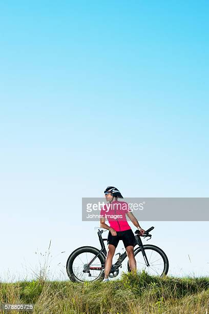 Cyclist standing with bicycle