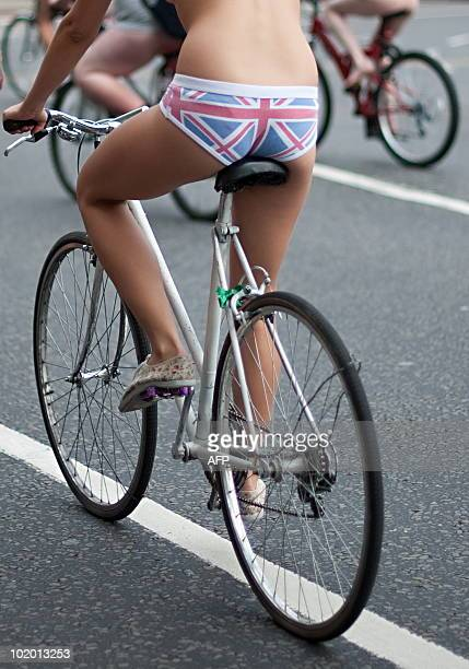 A cyclist takes part in the annual 'London World Naked Bike Ride' event in Piccadilly central London on June 12 2010 Now in it's seventh year the...