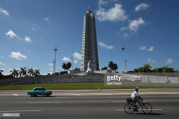 A cyclist taxi and pedestrian pass the Jose Marti Memorial in Revolution Square where Pope Francis will perform Mass during his visit to Havana on...