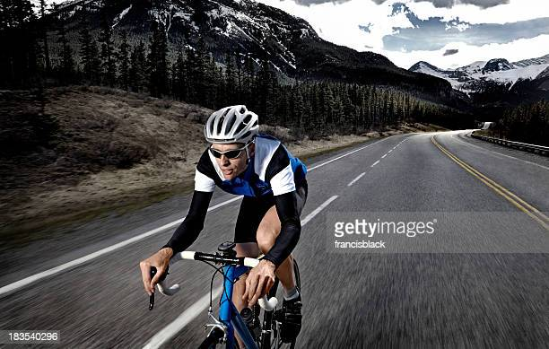 Cyclist training on a mountain road