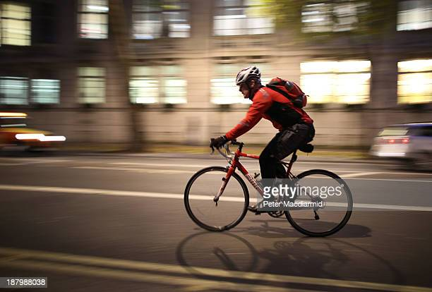 A cyclist travels along a street in the evening rush hour on November 14 2013 in London England