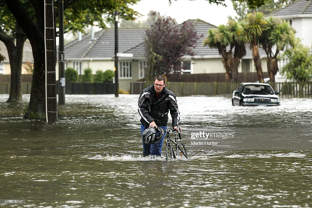 A cyclist wades through flooded streets in Edgeware on March 5, 2014 in Christchurch, New Zealand. A massive storm hit Canterbury yesterday causing floods, power outages and damaged property across the region.