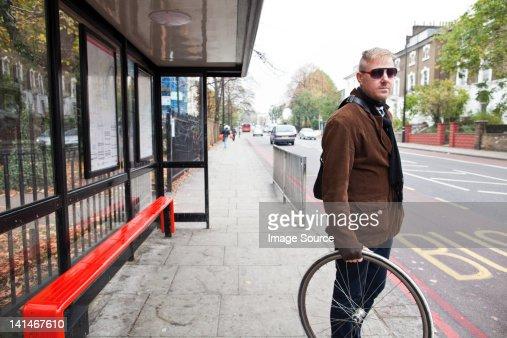 Cyclist waiting at bus stop
