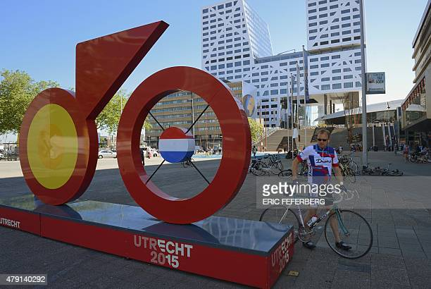 A cyclist walks with his bike past a giant sculpture of bike the logo of 'Utrecht 2015' in a street of Utrecht The Netherlands on July 1 three days...