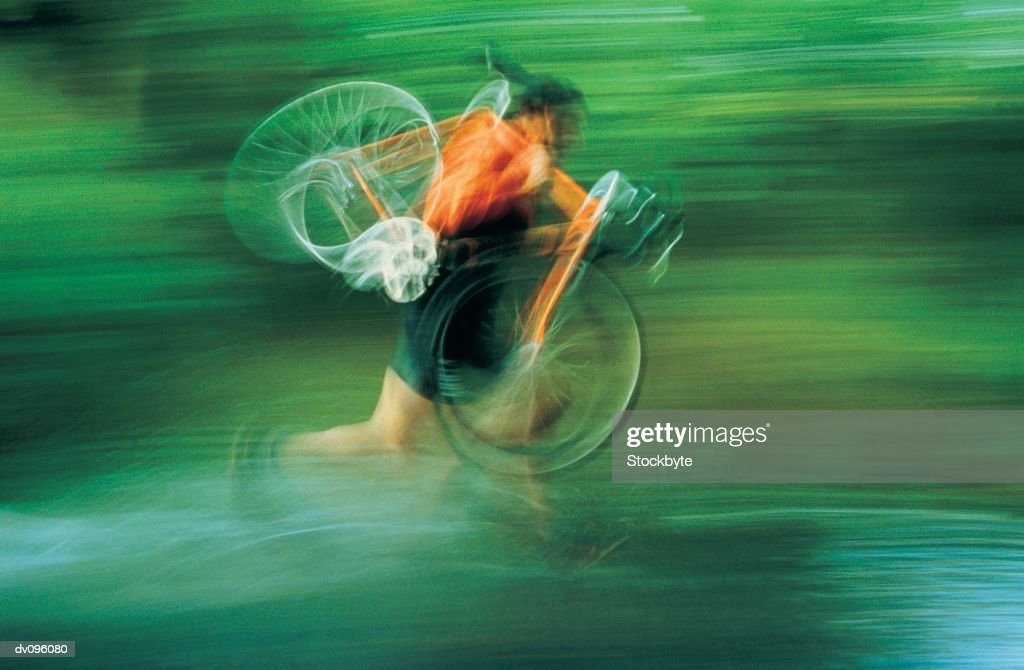 Cyclist with bike on shoulder, running : Stock Photo
