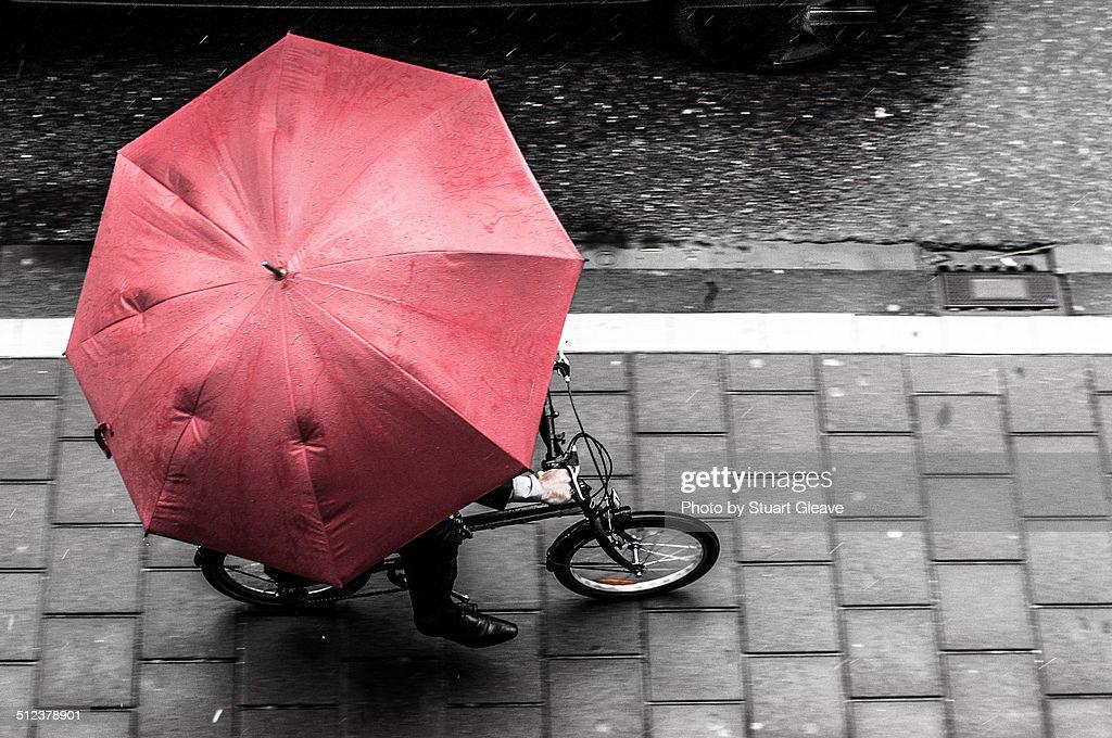 Cyclist with umbrella