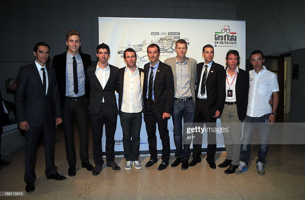 Cyclists Alberto Contador, Taylor Phinney, Thomas De Gendt, Mark Cavendish, Ivan Basso, the winner of the 2012 Giro d'Italia Ryder Hesjedal, Vincenzo Nibali, Rigoberto Uran and Joaquin Rodriguez pose after the presentation of the 96th Giro d'Italia (Tour of Italy) 2013 route on September 30, 2012, in Milan. The 2013 Giro d'Italia includes nearly 75 km of time trials for a total race distance of 3400 km. It will start in Naples on May 4 and finish in Brescia on May 26. AFP PHOTO /LUK BENIES