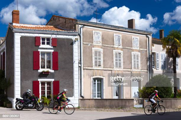 Cyclists and motorbike touring in the Marais Poitrevin region a Grand Site de France