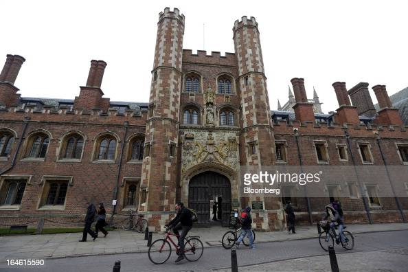 Cyclists and pedestrians pass St John's College part of the University of Cambridge in Cambridge UK on Friday March 22 2013 In 2011 the UK's...