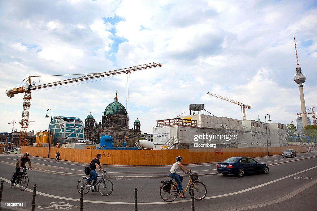 Cyclists and road traffic pass the construction site at Berlin Cathedral, also known as Berliner Dom in Berlin, Germany, on Tuesday, May 7, 2013. Germany, Europe's largest economy, reported growth in the construction industry during April, according to Markit Economics. Photographer: Krisztian Bocsi/Bloomberg via Getty Images