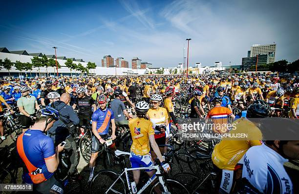 Cyclists approximately 13000 participants prepare to explore the course for the 102nd edition of the Tour de France in Utrecht The Netherlands on...
