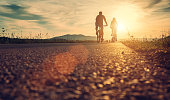 Cyclists are on the sunset road
