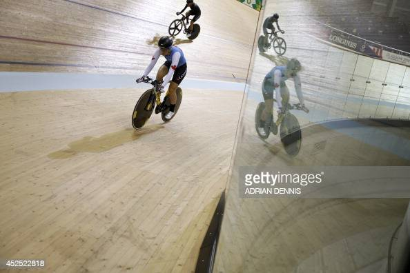 Cyclists are reflected in plexiglass shields as the participate in a training session at the Sir Chris Hoy Velodrome at the Emirates Arena in Glasgow...