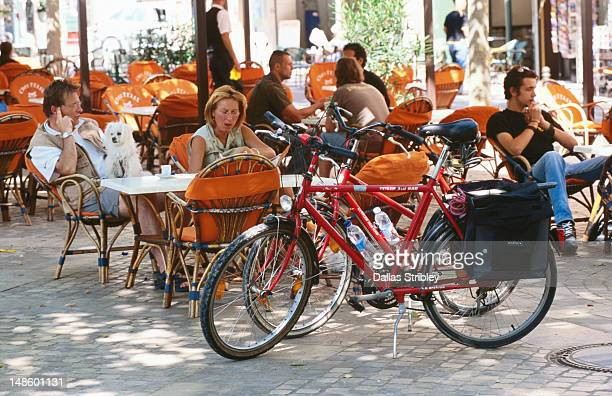 Cyclists at cafe in Place Carnot, Bastide St Louis.