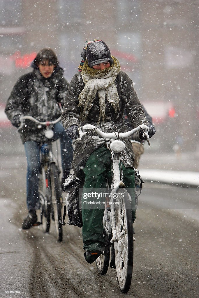 Cyclists brave the snow on February 8, 2007, in Amsterdam, Netherlands. The Dutch transport system has suffered delays across the country, with an expected 5-10 centimetres due to fall, according to The Dutch Meteorological Institute.
