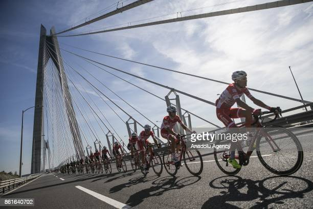 Cyclists compete as they cross the Yavuz Sultan Selim bridge one of the bridges that connects Asia and Europe continents during the 1437 kilometers...