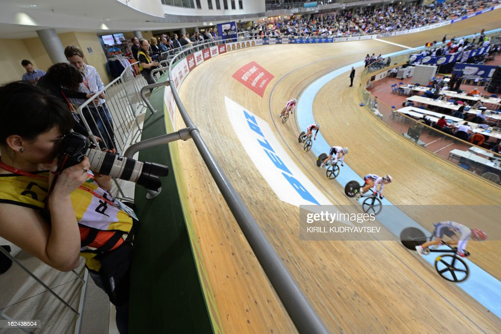 Cyclists compete at the UCI Track Cycling World Championships Women's 25 km Point Race in Belarus' capital of Minsk on February 23, 2013.