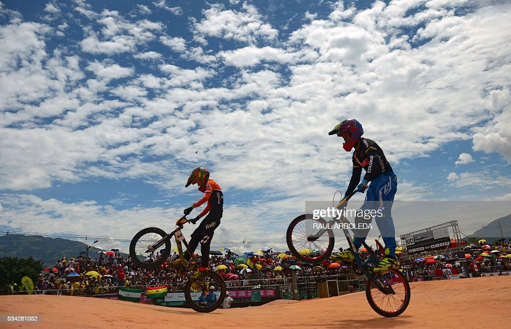BMX cyclists compete during classifications in the UCI BMX World Challenge, categories ages twelve, at Antonio Roldan Betancur challenger track in Medellin, Antioquia department, Colombia, on May 25, 2016 / AFP / -- / RAUL