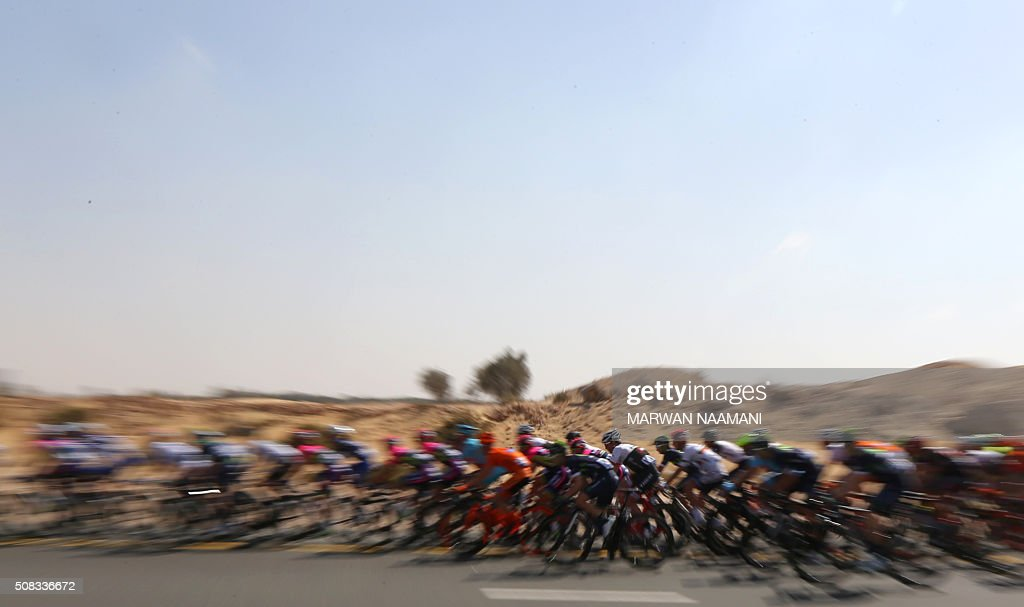 TOPSHOT - Cyclists compete during the second stage of Dubai Tour 2016 in Dubai on February 4, 2016. Italy's Elia Viviani, riding for Team Sky, sprinted to victory in the second stage of the Tour of Dubai and grabbed the leader's blue jersey from Germany's Marcel Kittel. Viviani had benefitted from a crash in the final kilometre that appeared to affect opponents. NAAMANI