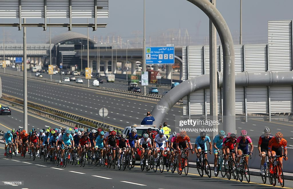 Cyclists compete during the second stage of Dubai Tour 2016 in Dubai on February 4, 2016. Italy's Elia Viviani, riding for Team Sky, sprinted to victory in the second stage of the Tour of Dubai and grabbed the leader's blue jersey from Germany's Marcel Kittel. Viviani had benefitted from a crash in the final kilometre that appeared to affect opponents. NAAMANI