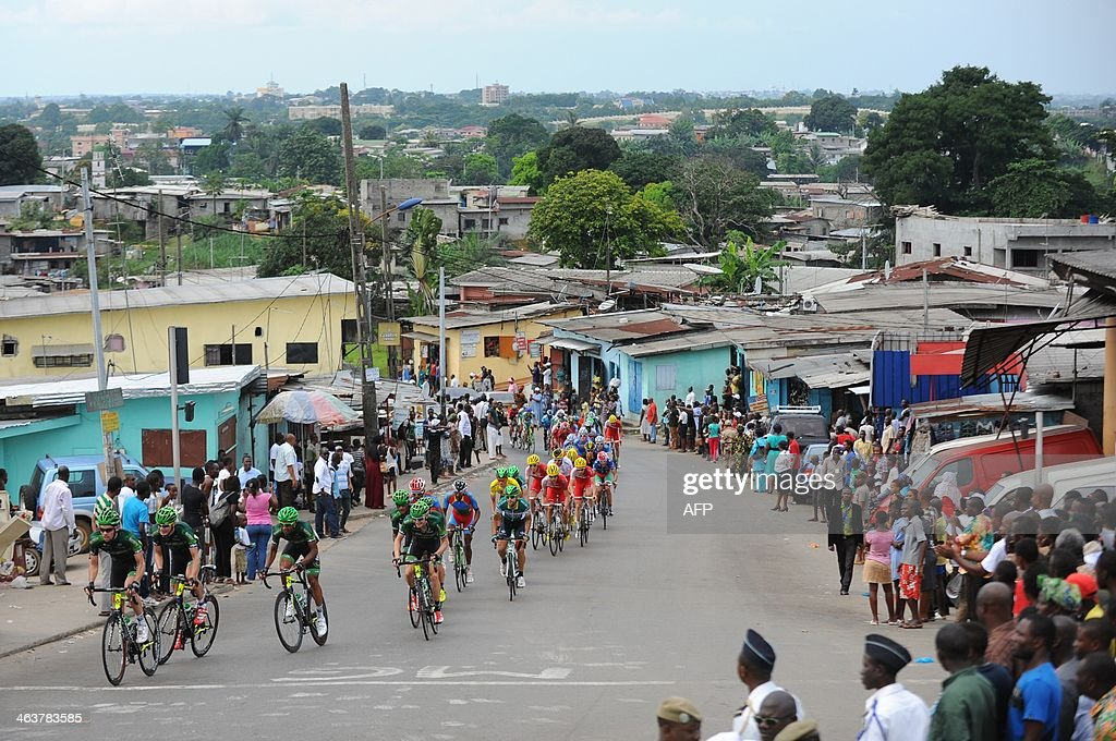 Cyclists compete during the seventh and last stage of the 9th Tropicale Amissa Bongo 2014 on January 19 2014 in Libreville Belgium's Frederique...