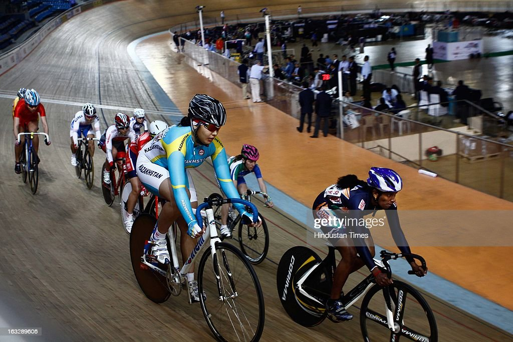 Cyclists compete in 20kms points race event during Asian Cycling Championship at IG Cycling Velodrome on March 7, 2013 in New Delhi, India.